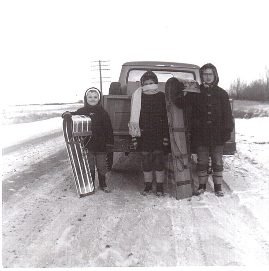 Vassie-l-r-Keith-Gwen-Gary tobogganing 1961