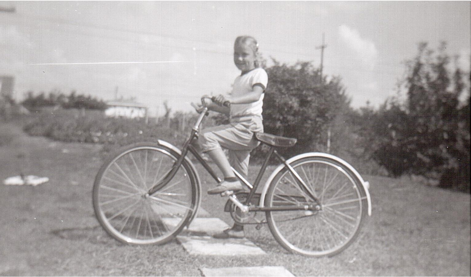 Montgomery- Lorraine on bike 1956