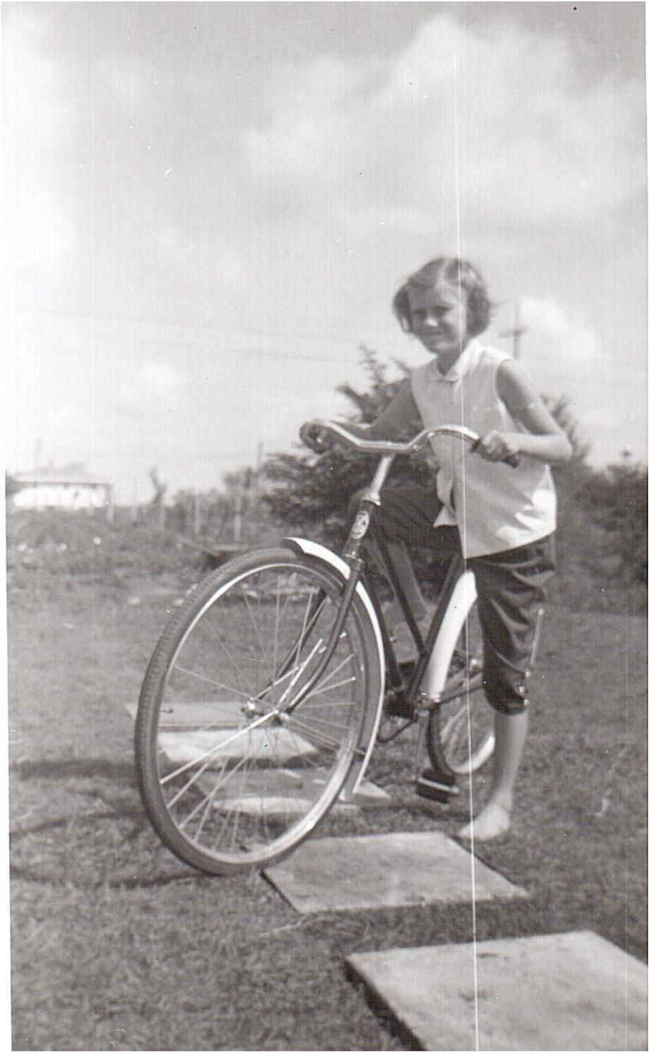 Montgomery- Lucille with bike 1956