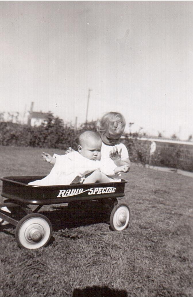 Montgomery- Lorraine and Lucille in wagon 1949